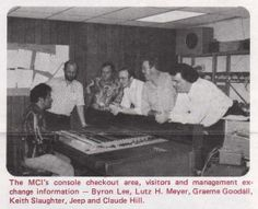 Byron Lee, Lutz H. Meyer, Graeme Goodall, Keith Slaughter, Jeep Harned, and Claude Hill checking out a MCI JH-500-50 @ MCI booth, 58th Audio Engineering Society Convention, 1977 in New York