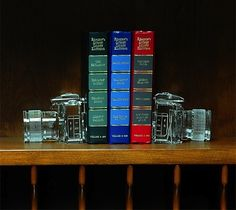 Awesome these can hold all my books  Crystal DSLR Bookends – $54