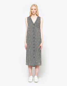 Easy dress from Stelen in Black. V-neckline. Thick straps. Left chest pocket. Darts at bust. Front button closure. Short side slits. Straight hem. Unlined. Casual fit.   • Rayon knit • 100% rayon • Hand wash cold, hang dry