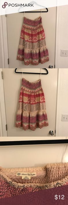Pink, Strapless AEO Sun Dress This American Eagle Outfitters Dress is perfect for the summer. Light and dark pink with a fun gray and gold pattern. Strapless and bunched at the top. Great, used condition. Size medium. American Eagle Outfitters Dresses Strapless
