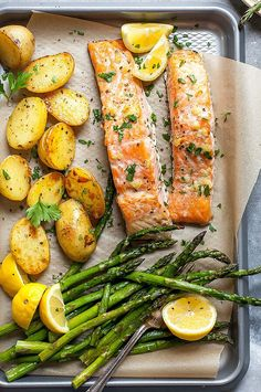 This spring-produce-packed one-pan meal makes a healthy and satisfying weeknight dinner. Melted garlic butter coats the salmon and vegetables, adding depth of flavor and richness to the dish. Tasty Meal, Healthy Dinner Recipes, Cooking Recipes, Thm Recipes, Vegetarian Recipes, Baked Salmon Recipes, Fish Recipes, Seafood Recipes, Drink Recipes