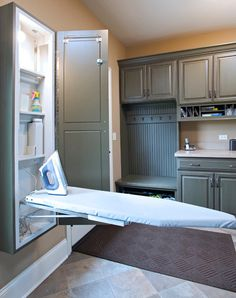 fold down ironing board // Traditional Laundry Room by John Hall Homes