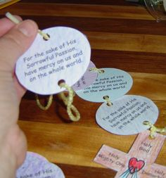 Divine Mercy chaplet craft; Same idea could be used to make a rosary - Yarn Paper, hole punch, preprinted words on labels or glued, colors or markers