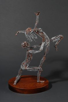 Wire sculpture at its finest. Dancing art.
