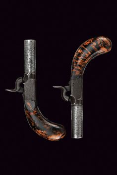A pair of percussion pocket pistols    provenance: Belgium dating:  mid-19th Century