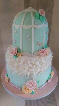 Bird cage wedding cake in pastel shades