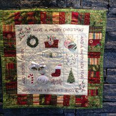 Appliqué and stitchery mini Christmas quilt