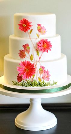 This cake would look so much prettier if the flowers went the whole way around the cake.