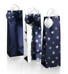 3 Blue & Silver Christmas Bottle Bags. A handy set of 3 bottle bags in blue with a pretty silver snowflake design on each. Perfect for gift emergencies, or when you've got lots of presents to pack. Approx. size: H370 x W120 x D90mm Pack of 3 bottle bags Silver ribbon handles Matching tags Special Size Type: One size. Price: $2.50