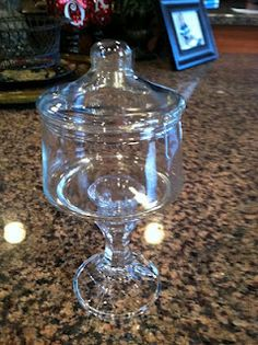 So easy I can't wait to make one. You just hot glue the candle stick to the bottom of the glass jar. Just $2 for both candlestick and jar.