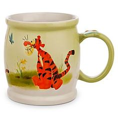 Disney Tigger Watercolor Mug | Disney StoreTigger Watercolor Mug - Watching pretty blue butterflies is absolutely what Tiggers like to do best. A charming watercolor design surrounds this large-size mug that's styled in the shape of a hunny jar, and features a cute 3-D butterfly on the handle.