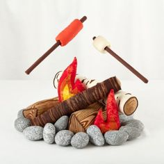 """There's nothing quite like huddling around a roaring plush campfire when you're roughing it in the rugged living room terrain.  This exclusive set contains over 20 pieces to create a cozy campfire experience when you're sleeping under the stars (and by """"stars"""" we mean """"ceiling fan"""")."""
