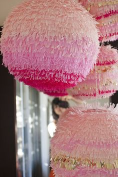 In shades of pink .... a DIY paper globe light that's been covered in fringe!  Cool!