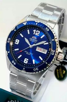 - blue-metallic dial - solid stainless steel bracelet with fold-over clasp and double push button - screw down stainless steel caseback with itemized coining - stainless steel case, exc. Cool Watches, Watches For Men, Wrist Watches, Stainless Steel Bracelet, Stainless Steel Case, Orient Watch, Watch Companies, Casio Watch, Seiko