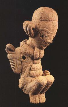 Nok sculpted pendant of a crouching figure, Nigeria, c. 500BC-500AD (terracotta)