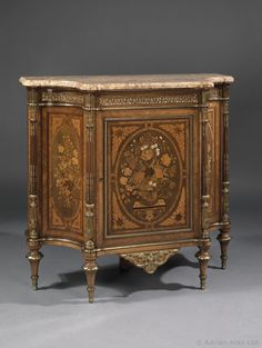 Attributed to HOLLAND & SON (1803-1968)  A Louis XVI Style Gilt-Bronze Mounted Marquetry Inlaid Side Cabinet