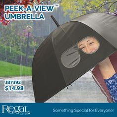 "PEEK-A-VIEW™ UMBRELLA  Goggle window cut-out provides clear view of the street ahead without lifting the umbrella. Dome-style umbrella protects from the wind and rain. Automatically opens with a press of a button. 32""L x 36""Diam."