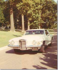 Elvis driving his 1972 Stutz Blackhawk at Graceland