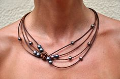 Freshwater Pearls and Leather Brown Peacock Reef Knot Necklace. $139.00, via Etsy.