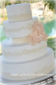 Buttercream tiers adorned with sugar pearls and handmade sugar flowers!