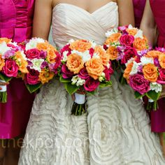 The girls carried similar bouquets of dahlias, freesias and roses.