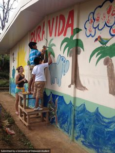 First year experience students mural painting in Costa Rica.