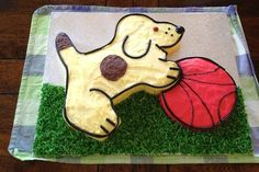"Hello Spot! From reader Kathryn: ""This is the cake I made for my son's 2nd birthday. I traced the picture from the book, blew it up to A3 size on the photocopier at work then used the copy as a template to cut out the dog shape from a slab cake, attached the dog to a 22cm round cake for the ball. Took me about 2 days all up. My son adored it!"""