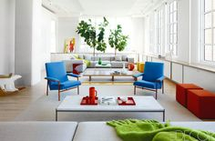Architect Lee Mindel of Shelton, Mindel & Associates was inspired by the simplicity, light, and color palette of a Scandinavian schoolroom for the Tribeca loft that Winsome Brown and Claude Arpels share with their daughters. In the living area, a pair of Pierre Guariche armchairs flanks a cocktail table by Poul Kjaerholm. The sofas, upholstered in a Kvadrat wool, and felt ottomans are by Paola Lenti. The rug is Irish, and the green throw is by Tomas Maier. Take a tour of the rest of this…