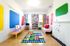 Love the bright splashes of colour on the walls and the funky photo wall