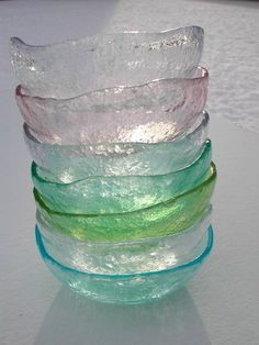 """Handmade glass as clear as water, tinted with hints of natural color, reminders of days spent combing the beach for bits of weathered glass.Made in the Veneto region of Italy, these bowls are perfect for every use beginning with breakfast and ending with gelato at the end of a long dinner.  Bowls measure 5.5"""" W X 2"""" H."""