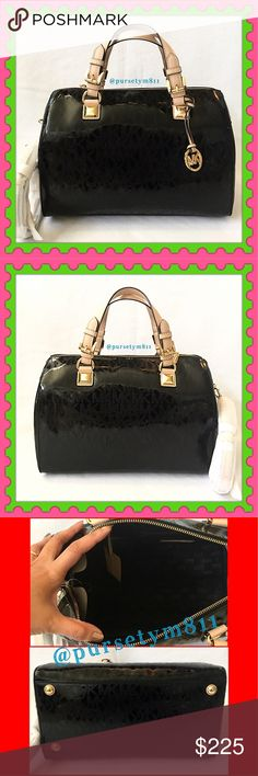 """Authentic Michael Kors LARGE Logo Handbag 100% AUTHENTIC! Beautiful classic logo black mirrored LARGE bag from Michael Kors! Crossbody, top handle & shoulder bag. Approximate measurements: Length 13 1/2"""" Height 9"""" Width 7 1/2""""w/ adjustable & detachable strap. Gold tone hardware. Zipper top closure w/ 5 interior pockets. Bottom feet for protection. GORGEOUS! No trade❌ PRICE FIRM. Michael Kors Bags"""