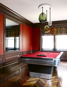 The walls of the billiard room are clad in an Hermès leather.
