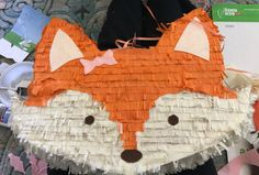 """Homemade fox piñata - draw your shape onto cardboard , cut 2 equal pieces , cut strips of cereal box for edging, tape together ( leave flap on top to fill) then I used tissue paper from the dollar store - leave it folded and cut a 1 1/2 """" strip, then cut a fringe halfway up , glue on strips (I ised school Glue and watered it down a little and used a foam brush) over lap layers of tissue paper and use paper or felt cut out for eyes. $2 fox piñata !"""