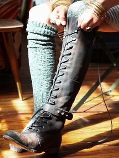 I would totally wear these knee high lace up boots... if I was about 2 feet taller...!