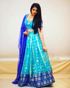 Stunning blue color pattu lehenga and blouse with net dupatta. you like experimenting with fresh colors combinations Half Saree Lehenga, Lehenga Gown, Lehnga Dress, Half Saree Designs, Lehenga Designs, Saree Blouse Patterns, Saree Blouse Designs, Lehenga Color Combinations, Frocks And Gowns
