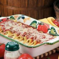 Manicotti with Spicy Sausage Recipe Main Dishes with italian spicy sausage, crushed tomatoes, marinara sauce, beaten eggs, ricotta cheese, grated parmesan cheese, green chilies, fresh parsley, italian seasoning, salt, garlic powder, pepper, manicotti shells, shredded mozzarella cheese