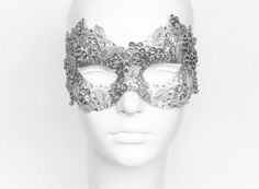 Silver Venetian mask with rhinestone and bead embellishments, fabric applique and sequin flowers. Worldwide delivery within 4 business days with online