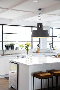 Contemporary white kitchen + industrial pendants