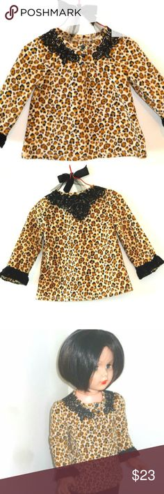 LEOPARD PRINT toddler top upcycled w/ black lace A size 18 months BUT check below measurements, I was able to fit it on child doll model, see photo!  Started with a cute black, beige, white leopard print polarfleece top and upcycle embellished it with sewn on black lace neck appliques front/back & cuffs for urban chic one-of-a-kind paroliro design French look.  FLAT measures: underarm:10.5 ins.; shoulder to cuff:10.5 ins.; center front top of neck to lower center front hem edge:12.75 ins…