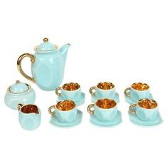 Fifteen piece vintage porcelain tea service in robin's egg blue with gold interiors. Includes tea pot, creamer, sugar dish, and six cups and saucers.