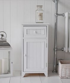 A Crisp White Freestanding Bathroom Storage Furniture Narrow Cabinet With One Drawer And Cupboard Each Wooden Tongue