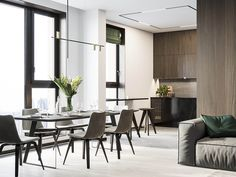 Interior Design Around Walnut Wood Finishes: 3 Great Examples Futuristisches Design, Design Case, Apartment Interior Design, Kitchen Interior, Wooden Accent Wall, Grande Table A Manger, Grey Sectional Sofa, Appartement Design, White Floor Lamp