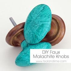 Porcelain knobs colored with a teal sharpie and baked in an oven.  Genius.