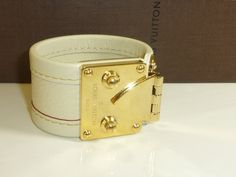 Stunning Louis Vuitton Suhali leather cuff Gorgeous cream leather with gold tone hardware Size small Height measures circumferenceComes with Louis Vuitton box Other than a few lightweight surface scuffs to the hardware this is in excellent condition Bracelet Box, Bangles, Bracelets, Leather Cuffs, Bag Sale, Louis Vuitton, Cream, Jewelry, Creme Caramel