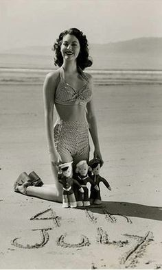 Ava Gardner | 4th of July | beach | patriotism | sand | swimmers | bathers | dolls | event | celebration |
