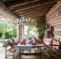 A porch at Ralph Lauren's Colorado ranch is furnished with Mexican sabino-wood pieces, including a table made from a salvaged door and ox yokes; the tableware and linens are by Ralph Lauren Home. Rustic Outdoor Spaces, Outdoor Rooms, Outdoor Dining, Patio Dining, Rustic Porches, Dining Room, Outdoor Seating, Colorado Ranch, Colorado House