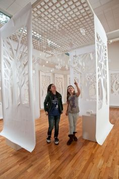 Positive and negative shapes - installation idea.  Kids could draw their positive/negative design, project onto the banner paper, and then hang in the skylight area