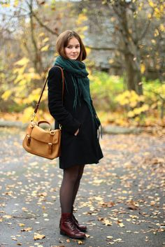 Red boots, green scarf. Leather bag
