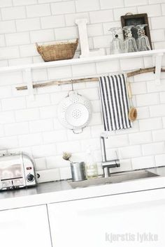 Branch for hanging tea towel, pots and utensils. So simple & pretty.