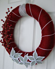 Like the poinsettias and the ribbon hanger. I might try a yarn wreath.